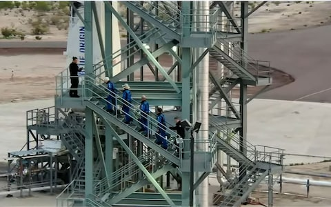 This still image taken from video by Blue Origin shows (L-R)Wally Funk, Jeff Bezos, Mark Bezos, and Oliver Daemen as they ascend the crew tower