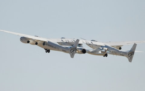 The Virgin Galactic SpaceShipTwo space plane Unity bound for the edge of space with Sir Richard Branson