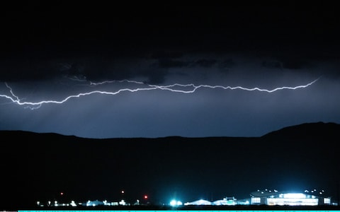 Lightning flashes over Spaceport America prior to the launch of Virgin Galactics SpaceShipTwo Unity in Truth Or Consequences, New Mexico.