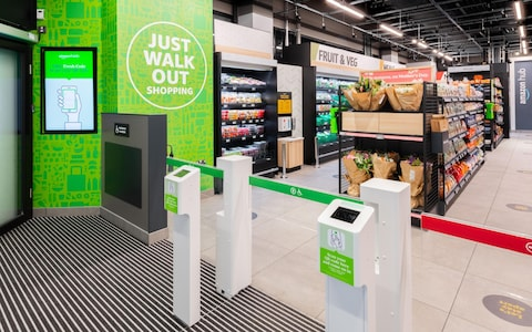 Shoppers scan a barcode on their phones to enter and are charged automatically for any items they walk out with