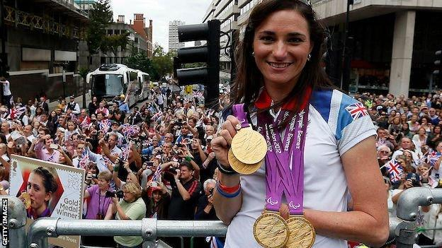 Sarah Storey shows off her gold medals at the London 2012 parade