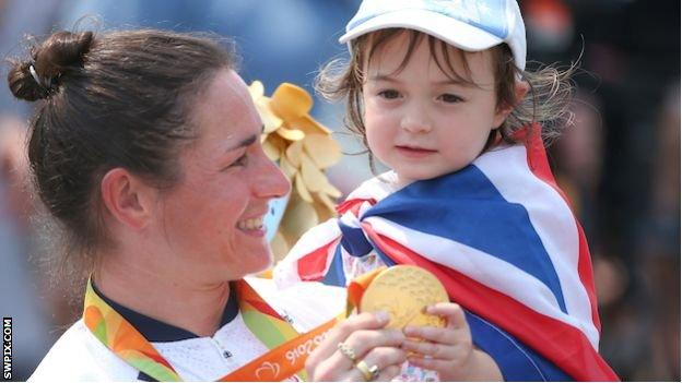 Sarah Storey and her daughter Louisa hold her gold medal at the Rio 2016 Paralympics
